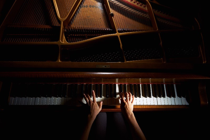 Playing classical music on a grand piano.