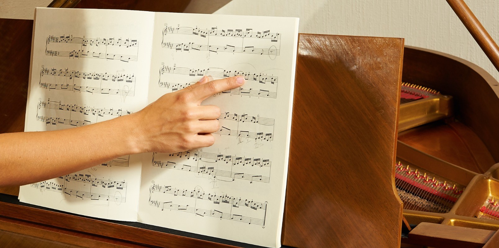 Teaching a piano student how to read sheet music.